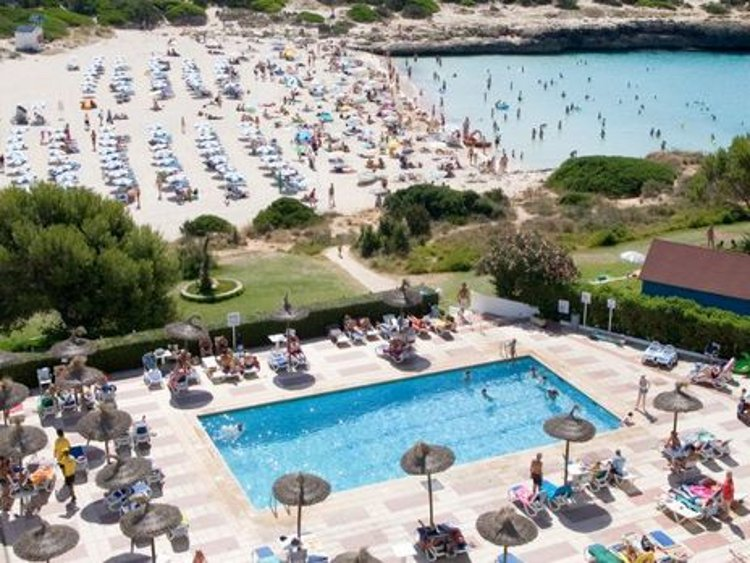 The swimming pool and beach at Hotel Cala n Bosch on Menorca